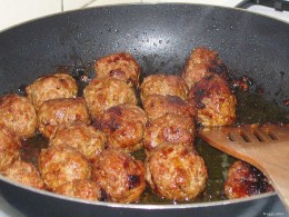 Meatballs Frying In A Pan.