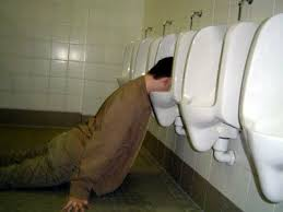 drunk and fell asleep in public toilet