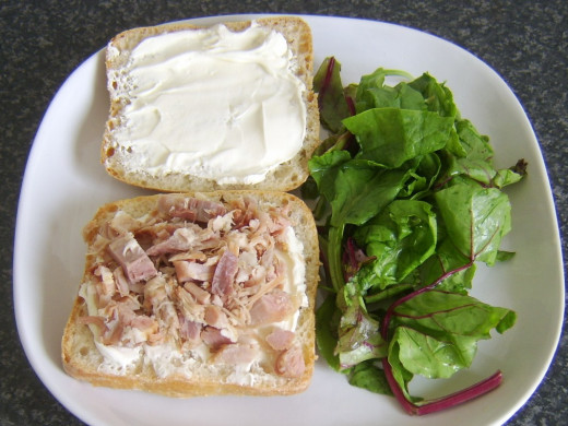 Ham pain rustica is plated with green salad leaves