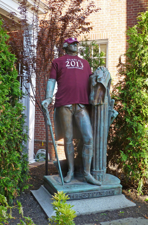 George Washington, Commander of the Colonial Army, wears Harvard gear in front of the Sheraton Commander hotel