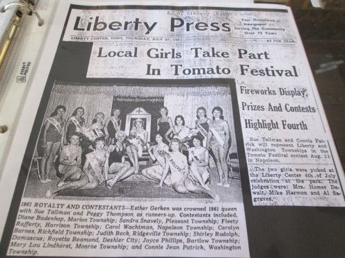 In 1959, the Henry County Fair began featuring the Tomato Festival (and Parade) Queen. This is a photograph of the 1961 festival announcement and crowned Queen, Esther Gerken, as well as all contestants, in a county newspaper.