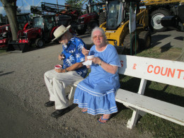 The Henry County Fair in Ohio is a popular event in the summertime for senior citizens. This couple enjoys homemade raspberry ice cream as they sit a spell.