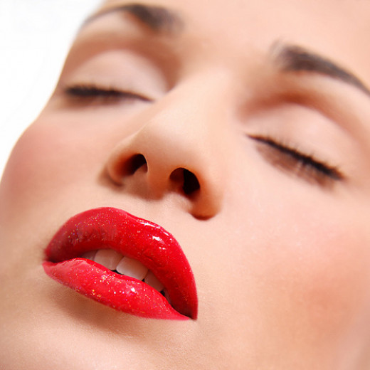Woman face with passionate red lips from Nikola Ilic flickr.com