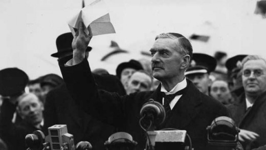 Neville Chamberlain waving the Munich Agreement.