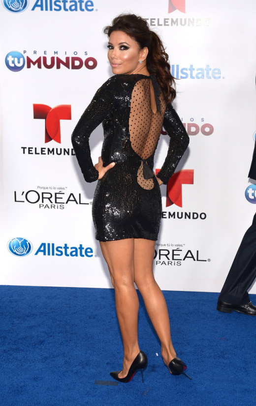 Eva Longoria in a short evening dress and high heels for a Telemundo appearance