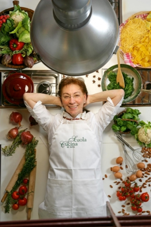 Lella  strikes a pose in her lovely kitchen where  Italian cooking classes are held.