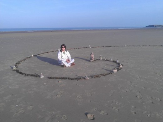 My wife and I are fans of temporary art and sacred geometry. I made this fibonaci spiral with towered stones and seaweed on Rhossili beach :)