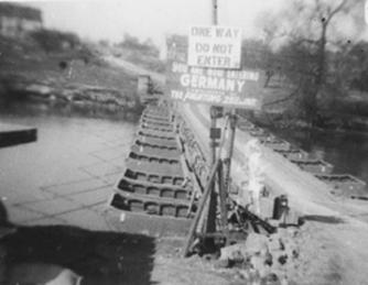 Sign put up by the men of the 253rd Infantry as they entered Germany.