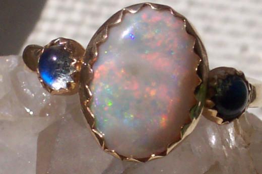 Clouded opal with reddish streaks in it.