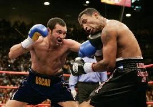 Oscar De La Hoya knocked out Ricardo Mayorga in a junior middleweight bout. De La Hoya also won a gold medal in the 1992 Olympics.