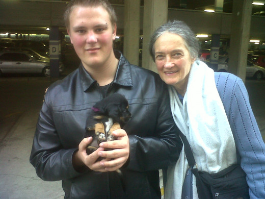 "My son Danyil-Jon at a time when he was suffering from depression, with his legendary ""black jacket"". Here he is with his grandmother and puppy."