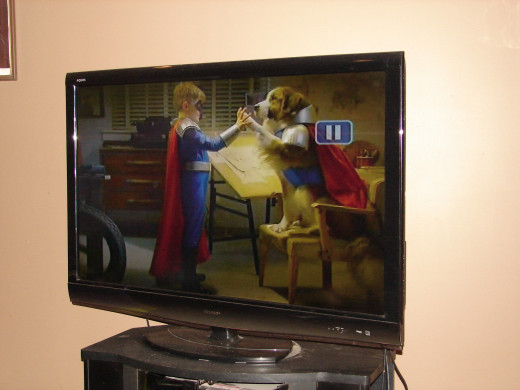 This 42 inch flat screen, high definition color television set is made by Sharp. Flat screens really took off when they were invented.