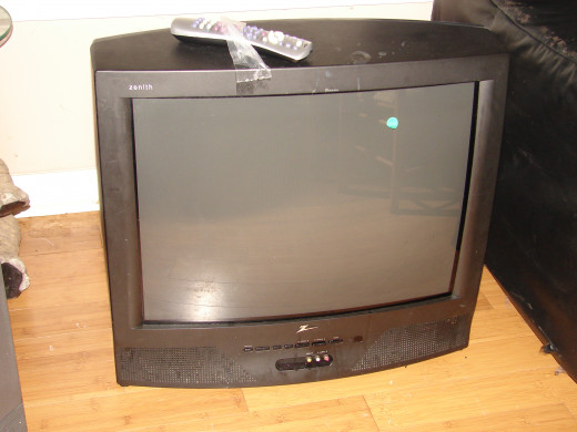 Zenith is the make of this 27 inch television set. The universal remote on top of the set was invented to work with any set and it combines cable, DVD and VCR buttons on one remote.