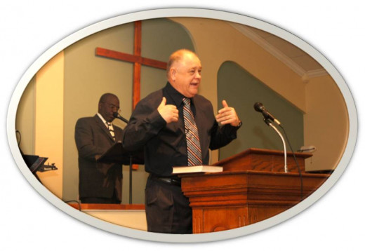 Pastor Gary Larrimore preaching during Sunday morning church service.