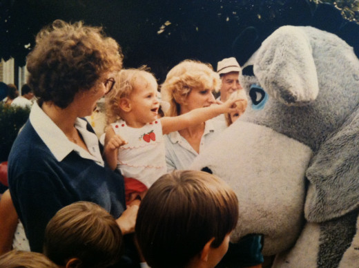 That's my mom holding me up to pet Eeyore at the Magic Kingdom.
