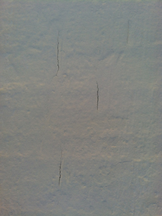 Cracks in this exterior wood siding date the home.