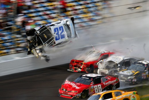 Despite this crash at Daytona, Larson (seen airborne here) is in the top ten in Nationwide points