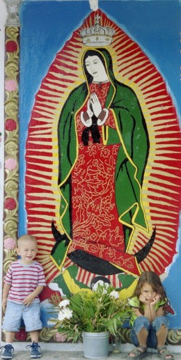 Painting of Our Lady of Guadalupe on a corner in Guadalajara, Mexico, 2005...(author's children)