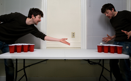 Leaning Over Table to Shoot is a Forbidden act according to Beer Pong Rules