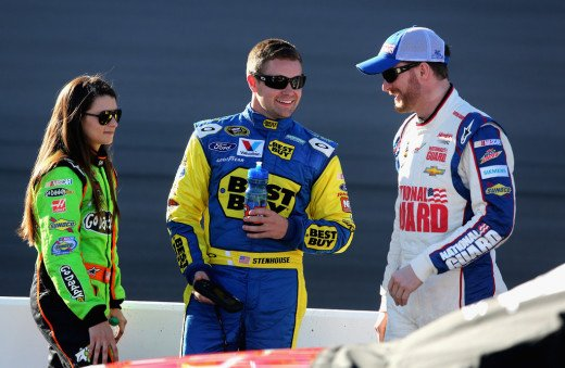 NASCAR rookies Danica Patrick and Ricky Stenhouse Jr. discuss things on the track with Dale Earnhardt Jr.