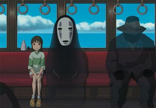 Chihiro and Kaonashi (No-Face) taking a train to Zeniba's residence