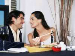 A man and a woman on a date sharing a meal together.