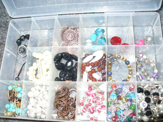 Storing jewelry in a divided container keeps each piece separate.