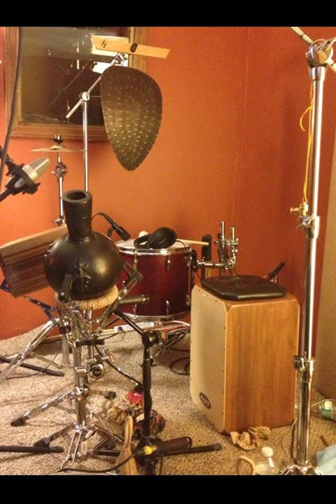 Jimmy Lopez uses a cajon in the center of his percussion rig.
