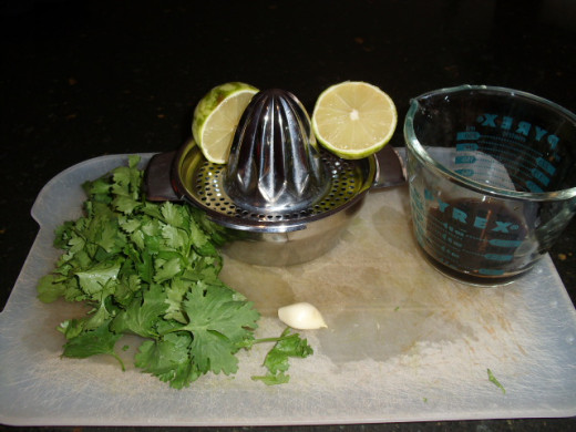 Juice your lime, rough chop your cilantro, and mince your garlic.