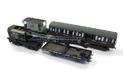 Crane train. At the back an Airfix/Dapol unfitted brake to the left of a modified Ian Kirk coach (part of a quad-art set). At the front is the crane runner to the left is the crane itself. I intend to convert a 4-wh. pigeon/parcels van to a tool van