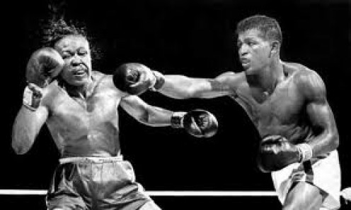 Sugar Ray Robinson lands a big right to the chin of Kid Gavilan. Sugar Ray won this built by fifteen round decision in defense of his Welterweight World Title.