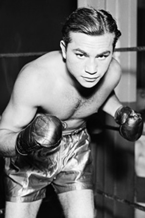 Barney Ross is a former Jr. Welterweight and Welterweight Champion. This boxer could box or bang and he took on all comers.