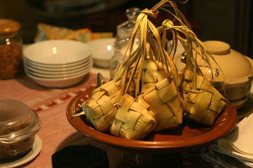 Ketupat, a type of dumpling in which rice is wrapped in woven palm leaves. It is a common delicacy and symbol during Hari Raya Puasa