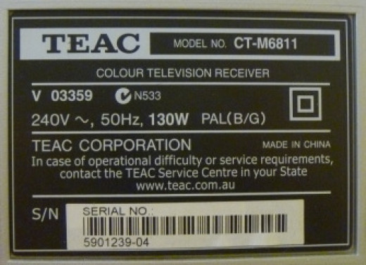 A power tag at the back of a TV. 130W for a period of 3 hours per day will make up for a 0.39 KWh of electrical consumption per day.