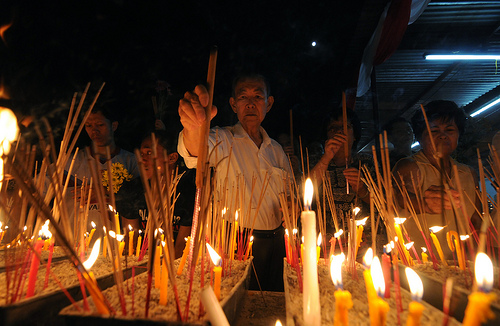 Buddhists offering prayers during Wesak Day