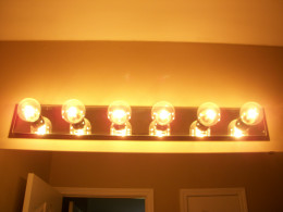 Glass bulbs like the ones shown here are popular in bathrooms. I usually take each one down and hand wipe until dust is gone.