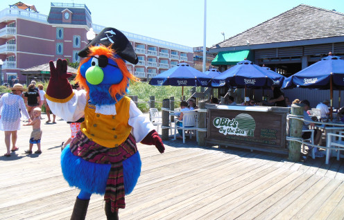 Pirate Pete waving to the crowds and posing for photos on the Rehoboth Beach Boardwalk while he looks for young people who would like to ride on the Cape May Lewes Ferry with him.
