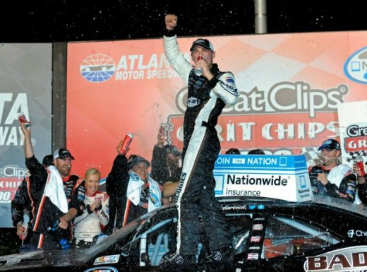 Meanwhile, Kevin Harvick celebrates after dominating this weekend's Nationwide race in Atlanta