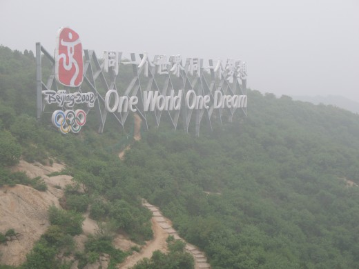 The olympic sign on the face of the Great Wall