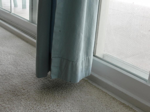Curtains should hang clear off the floor.