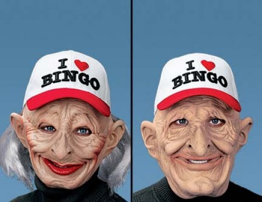 "Bingo Mask will have folks shouting more than ""Bingo""! They'll be startled at the sight of this full-face mask and cap combo that'll create a sensation at Halloween gatherings or costume parties. Female mask sports gray hair, lipstick and rouged ""che"
