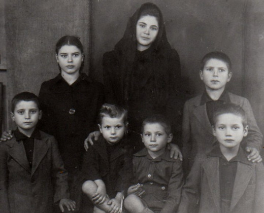 My mother Mary (the oldest in the middle) and her siblings grieving as orphans.