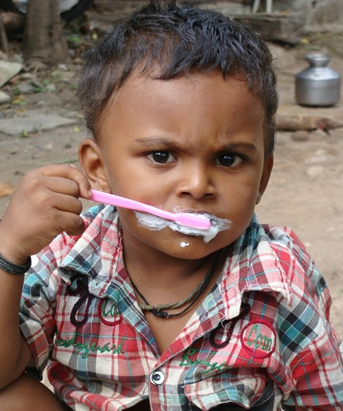 A  Child brushing his teeth