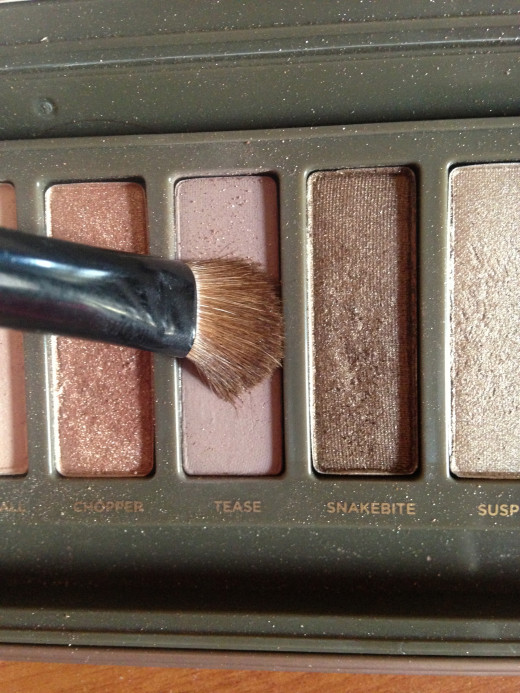 Step One: Use a matte brown color (in the Naked 2 Pallet it's tease.
