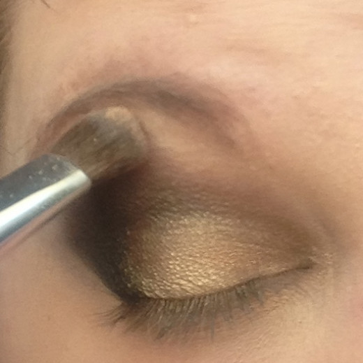Step One: Apply the light shimmer to the tops of your lids, above your crease. Blend it in!
