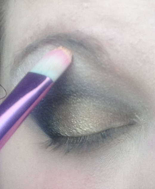 Step Three: Apply that color as the highlight. Just follow the bottom curve of your brow!