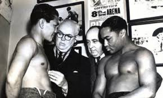 Two All-Time great prepare to do battle. Henry Armstrong and Barney Ross.