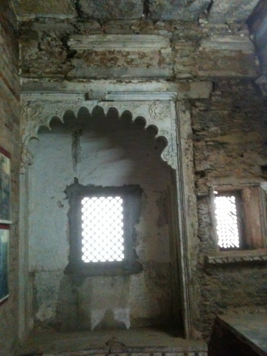 Intricately carved balcony with a window called 'jharokha'.