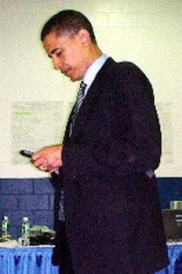 Obama on his Blackberry.