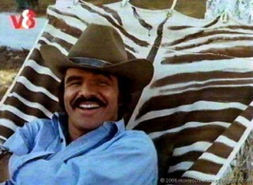 "Bandit from ""Smokey and the Bandit"" laughing at Big & Little Enos' size and outfits."